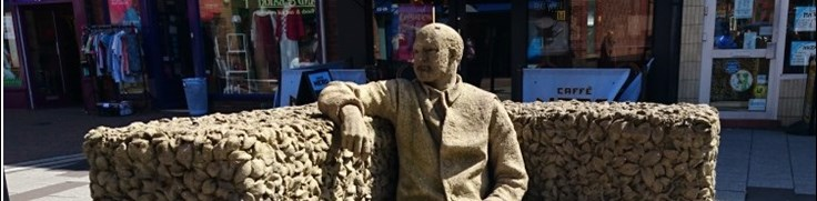 The Beeston Seat - Sculpture of Man Seated in Beeston
