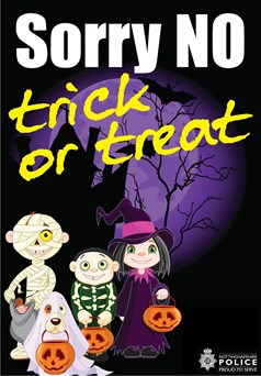 Sorry No Trick or Treat in front of a spooky castle with three trick or treaters and a dog in a ghost costume below.