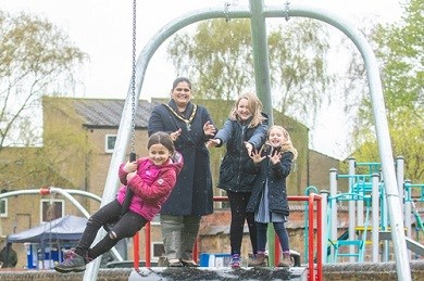 The Mayor of Broxtowe helps Ava Whitehead enjoy the official opening of Broadgate Park's brand new zip wire along with Emma and Lucy Raynor