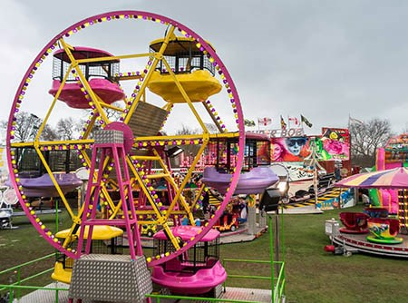 Bramcote Hills Fun Fair with Ferris Wheel and Tea Cups. Photo by Phil Heath Photography