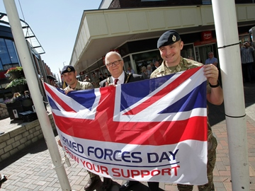 Sgt Bentley, the Mayor of Broxtowe, Cllr Derek Burnett BEM, and Cpl Lythgoe pose with the Armed Forces Day flag before it is raised.