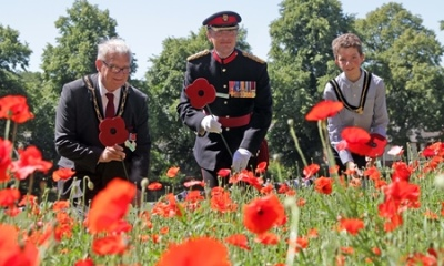 Mayor of Broxtowe, Cllr Derek Burnett BEM; Commander 170 (Infrastructure Support) Engineer Group, Colonel Pete Quaite; and Youth Mayor of Broxtowe, Alfie Russell, lay wooden poppies next to the stream of poppies in memory of soldiers from Kimberley who were killed during the First World War.