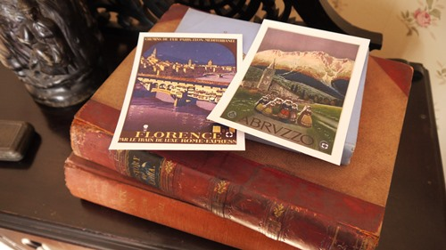 Two postcards on top of two old books at the D.H. Lawrence Birthplace Museum