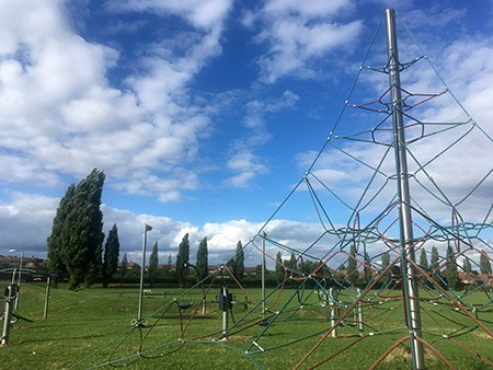 Inham Nook - Large rope climbing frame against the open field and blue sky
