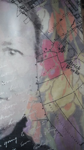 Fabric canvas with D.H. Lawrence's face, words, and a map