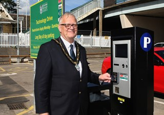 The Mayor tries out the new ticket machine