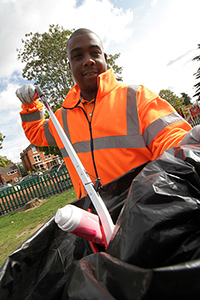 Council Officer, Moses Bogle collects litter
