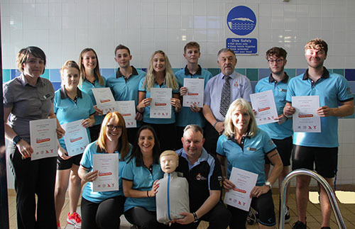 Kimberley Leisure Centre Lifeguards standing by the pool with their award