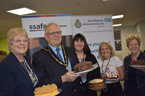 The Mayor and Mayoress join Council Officers and Councillor Jan Goold in hosting the Employee Christmas Cake Sale.