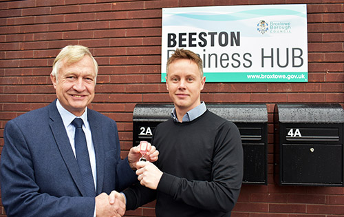 Cllr Tony Harper hands the keys for the Beeston Business Hub to Philip Davis of Island HVAC Systems