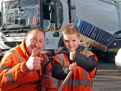 A refuse man and a schoolchild