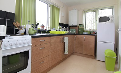 Modernised Kitchen with green curtains