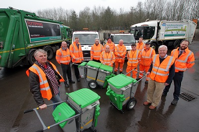 Councillors and Officers with newly decorated bin lorries