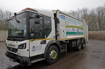 Newly decorated bin lorry with clean and green poster on the side