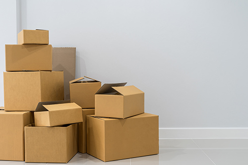 Moving boxes piled in a corner
