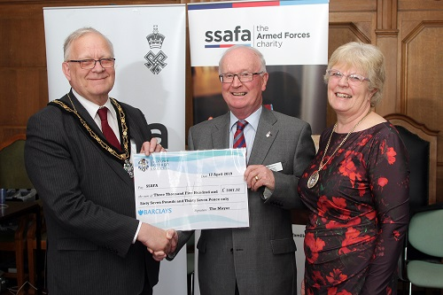 Mayor and his wife giving a large cheque to Ken Scott from SSAFA