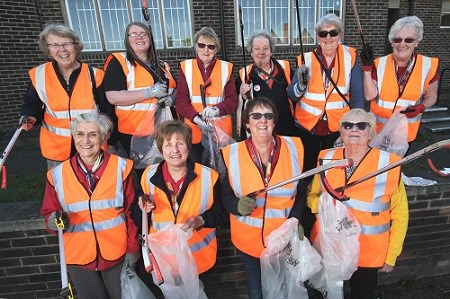 Ladies from the Beauvale Trefoil Guild in high vis jackets on a litterpick