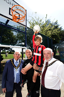 Mayors of Broxtowe and Stapleford help a child score a basket in new MUGA