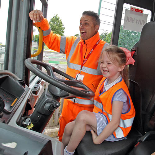 Schoolgirl learning about Refuse Vehicle
