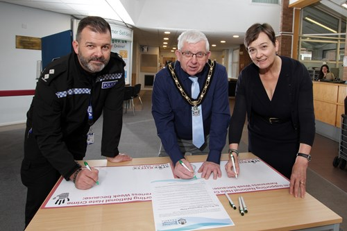 Simon Riley, The Mayor and Ruth Hide signing the Hate Crime Pledge