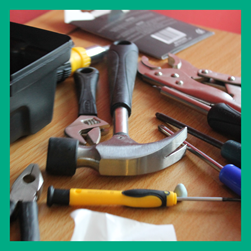 Selection of hand held tools on a table