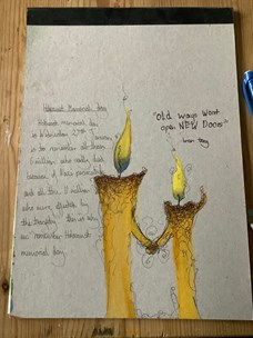 Piece of work from Alderman White student Zac Draper with drawing of two candles holding hands