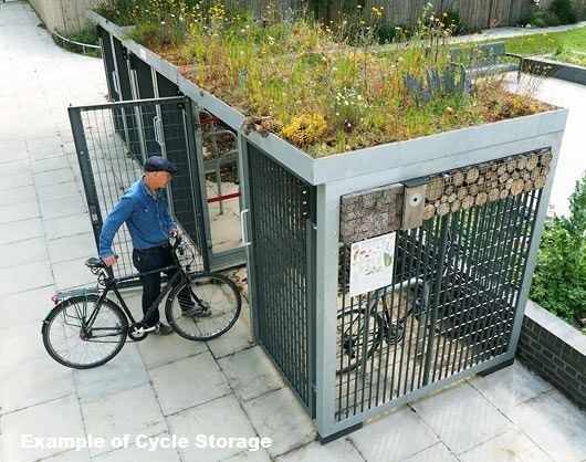 Cycle Storage Cage with Ecosystem on Roof. Older Man trying to park a bike.